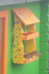 bird feeder with birds eating